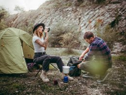 Couple camping at a campsite in the mountains.