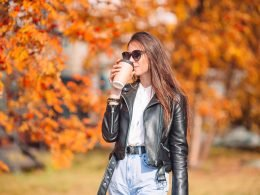 Woman drinking coffee during the Fall.