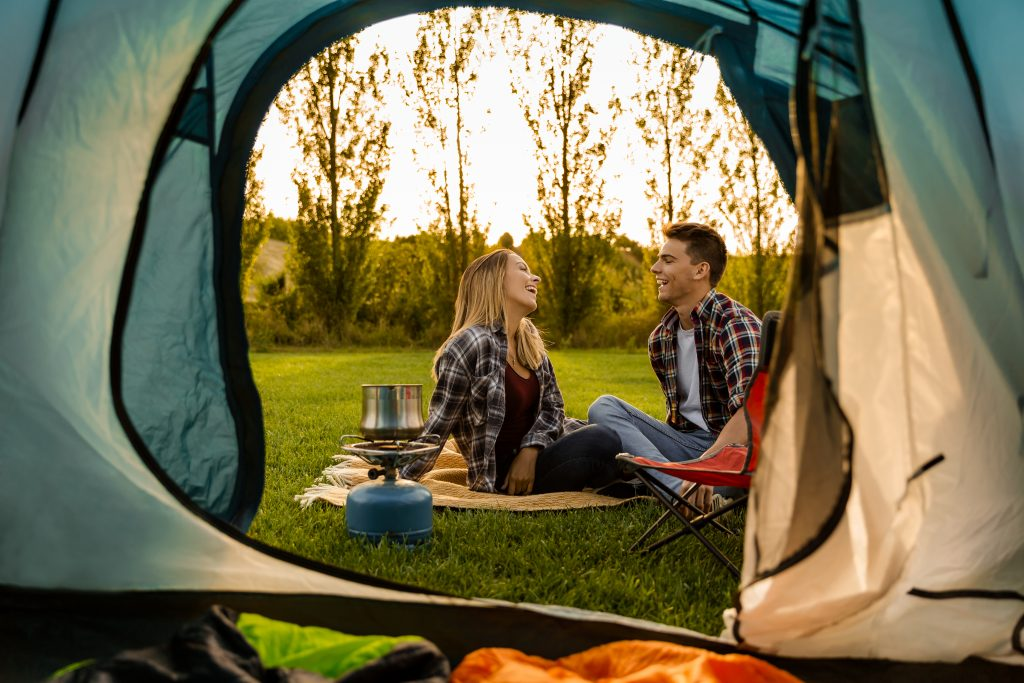 Couple enjoying their campground in the woods.