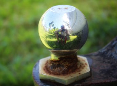Close up of a weather hitch ball reflecting camera man in metal.
